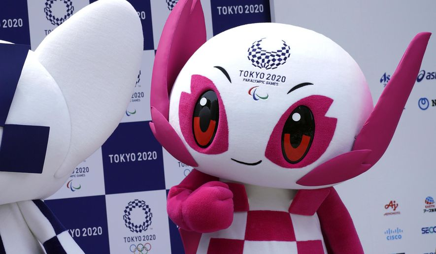 """FILE - In this July 22, 2018, file photo, Tokyo 2020 Paralympic mascot """"Someity"""" stands at stage during their debut event in Tokyo. Tokyo organizers said Monday, Aug. 16, 2021, what everyone expected: fans will be barred from the Paralympic Games during the pandemic, as they were from the just-completed Tokyo Olympics.(AP Photo/Eugene Hoshiko, File)"""