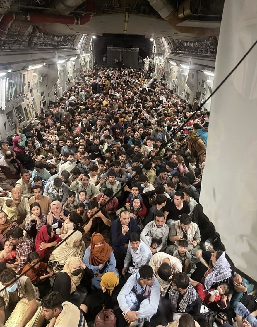 Afghan citizens pack inside a U.S. Air Force C-17 Globemaster III, as they are transported from Hamid Karzai International Airport in Afghanistan, Sunday, Aug. 15, 2021.  The Taliban on Sunday swept into Kabul, the Afghan capital, after capturing most of Afghanistan. (Capt. Chris Herbert/U.S. Air Force via AP)