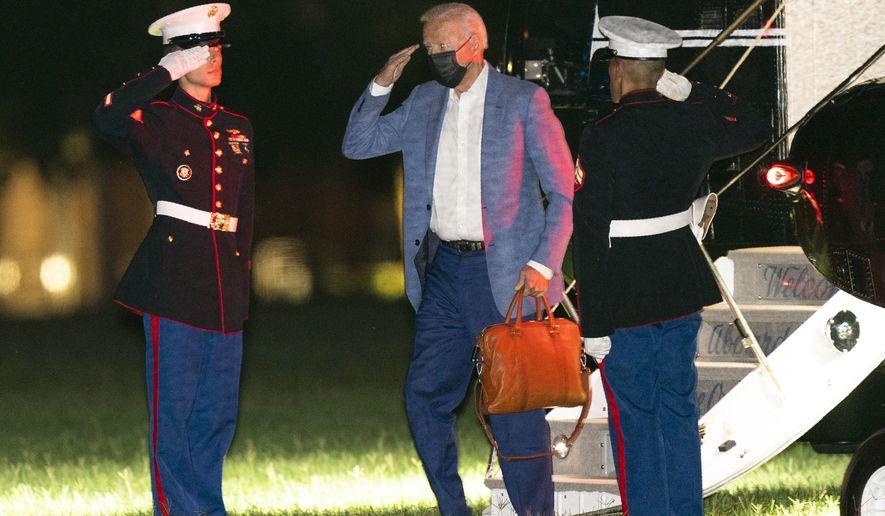President Joe Biden arrives at Fort Lesley J. McNair in Washington from Camp David retreat, Tuesday, Aug. 17, 2021. (AP Photo/Manuel Balce Ceneta)
