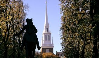 In this Nov. 7, 2018, file photograph, the Old North Church stands behind a statue of Paul Revere in the North End neighborhood of Boston. The church is famous as the place where in 1775 two lanterns in the steeple signaled that the British were heading to Concord and Lexington, but it's not well known that some of the church's early congregants were slave holders. Now the church, with a grant from the National Endowment for the Humanities, is integrating that history into its educational mission. (AP Photo/Steven Senne, File)