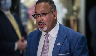 Education Secretary Miguel Cardona speaks to press after a visit to P.S. 5 Port Morris, a Bronx elementary school, Tuesday, Aug. 17, 2021 in New York. (AP Photo/Brittainy Newman)