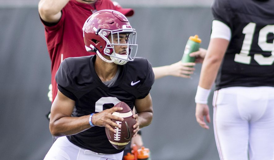 Alabama quarterback Bryce Young (9) rolls out on a passing drill during the NCAA college football team's practice Thursday, Aug. 12, 2021, in Tuscaloosa, Ala. (AP Photo/Vasha Hunt) **FILE**