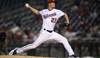 Washington Nationals starting pitcher Erick Fedde (23) delivers during the third inning of a baseball game against the Toronto Blue Jays, Tuesday, Aug. 17, 2021, in Washington. (AP Photo/Nick Wass)
