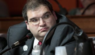 FILE - In this March 2, 2015, file photo shows Wisconsin Republican state Rep. Andre Jacques at a labor committee hearing at the State Capitol in Madison, Wis.  Jacques, one of the Legislature's most conservative lawmakers and a vocal opponent of mask and vaccine mandates, tested positive for COVID-19 last week and was at the hospital on Monday, Aug. 16, 2021 with pneumonia. (Michael P. King/Wisconsin State Journal via AP, File)