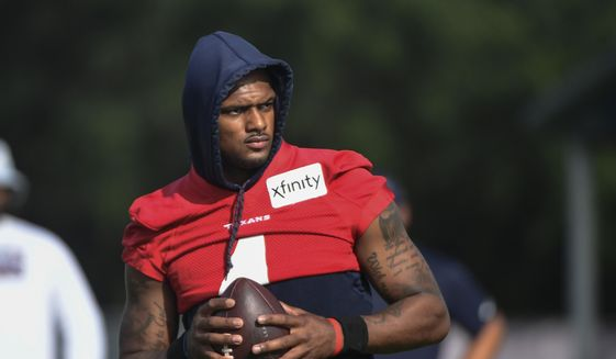 In an Aug. 2, 2021 file photo, Texans quarterback Deshaun Watson practices with the team during NFL football practice in Houston. Attorneys involved in the lawsuits accusing Watson of sexual assault and harassment say the FBI has become involved in the case. Tony Buzbee, the attorney for the 22 women who have sued Watson, said Wednesday, Aug. 18, 2021 he and some of his clients have spoken with FBI agents about the allegations against Watson.(AP Photo/Justin Rex_file) **FILE**