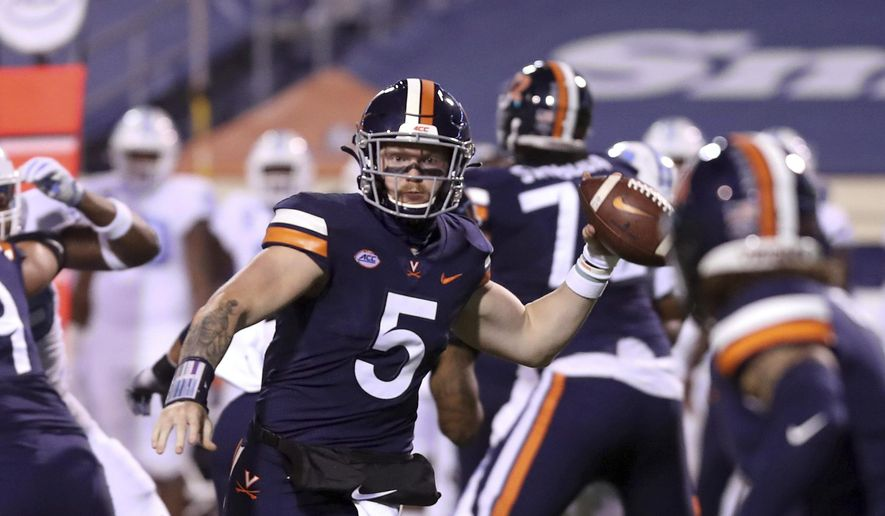 Virginia quarterback Brennan Armstrong (5) throws a pass to tight end Billy Kemp IV (4) during the team's NCAA college football game against North Carolina on Saturday, Oct. 31, 2020, in Charlottesville, Va. Armstrong is back at quarterback. (Andrew Shurtleff/The Daily Progress via AP, File) **FILE**