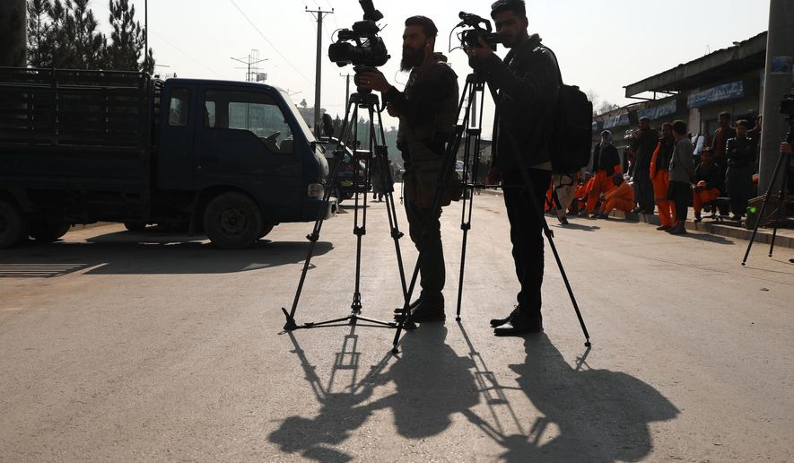 Afghan journalists film at the site of a bombing attack in Kabul, Afghanistan, Tuesday, Feb. 9, 2021.  (AP Photo/Rahmat Gul)