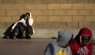 Asylum seekers wait for news of policy changes at the border, Friday, Feb. 19, 2021, in Tijuana, Mexico. A federal appellate court refused late Thursday, Aug. 19 to delay implementation of a judges order reinstating a Trump administration policy forcing thousands to wait in Mexico while seeking asylum in the U.S. President Joe Biden had suspended former President Donald Trumps Remain in Mexico policy on his first day in office and the Department of Homeland Security said it was permanently terminating the program in June, according to the court record.  (AP Photo/Gregory Bull) **FILE**