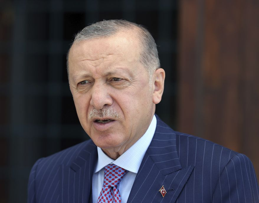 Turkey's President Recep Tayyip Erdogan speaks to the media after Friday prayers, in Istanbul, Friday, Aug. 20, 2021. The European Union should assist Afghans both inside Afghanistan and in neighboring countries in order to avoid a new migration wave, Erdogan told Greece's Kyriakos Mitsotakis in a telephone call Friday. Erdogan and Mitsotakis discussed developments in Afghanistan in a rare call as both countries raise concerns about a potential major influx of people fleeing the Taliban.(Turkish Presidency via AP, Pool)