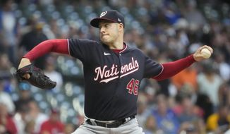 Washington Nationals starting pitcher Patrick Corbin throws during the first inning of a baseball game against the Milwaukee Brewers Friday, Aug. 20, 2021, in Milwaukee. (AP Photo/Morry Gash)