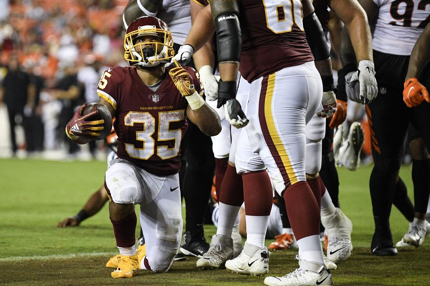 Washington Football Team running back Jaret Patterson (35) celebrates his touchdown during the second half of a preseason NFL football game against the Cincinnati Bengals, Friday, Aug. 20, 2021, in Landover, Md. (AP Photo/Nick Wass) **FILE**
