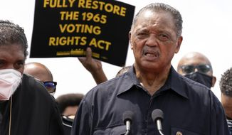 In this Monday, Aug. 2, 2021, file photo, the Rev. Jesse Jackson speaks to the crowd during a demonstration supporting voting rights, on Capitol Hill, in Washington. The Rev. Jesse Jackson and his wife, Jacqueline, have been hospitalized after testing positive for COVID-19, according to a statement Saturday, Aug. 21, 2021. He is vaccinated against the virus and publicly received his first dose in January. According to a statement released Saturday evening, the Jacksons are being treated at Northwestern Memorial Hospital in Chicago. He is 79 years old. Jacqueline Jackson is 77. (AP Photo/Jose Luis Magana, File)