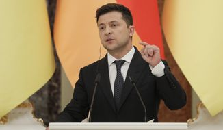 Ukrainian President Ukrainian President Volodymyr Zelenskyy attends a joint news conference with German Chancellor Angela Merkel following their talks at the Mariinsky palace in Kyiv, Ukraine, Sunday, Aug. 22, 2021. German Chancellor Angela Merkel arrived to Kyiv for a working visit to meet with top Ukrainian officials. (Sergey Dolzhenko/Pool Photo via AP)