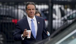 Then-New York Gov. Andrew Cuomo prepares to board a helicopter after announcing his resignation, Tuesday, Aug. 10, 2021, in New York. (AP Photo/Seth Wenig) ** FILE **