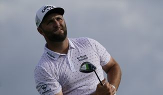 Jon Rahm, of Spain, watches his shot off the 15th tee in the third round at the Northern Trust golf tournament, Saturday, Aug. 21, 2021, at Liberty National Golf Course in Jersey City, N.J. (AP Photo/John Minchillo) **FILE**