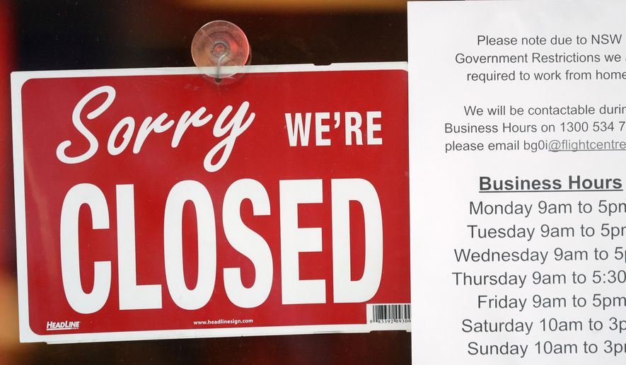 A commercial business is closed in Sydney on Aug. 13, 2021, as greater Sydney continues a weeks-long COVID-19 lockdown. Japan, Australia and New Zealand all got through the first year of the coronavirus pandemic in relatively good shape, but now are taking very divergent paths in dealing with new outbreaks of the fast-spreading delta variant. (AP Photo/Rick Rycroft)