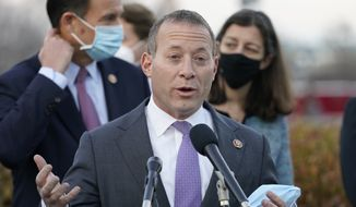 In this Dec. 21, 2020, file photo, Rep. Josh Gottheimer, D-N.J., speaks to the media on Capitol Hill in Washington. Nine moderate House Democrats are trying to upend leaders' plans for enacting President Joe Biden's multitrillion-dollar domestic agenda. Top Democrats want the House to quickly approve a budget resolution setting up future passage of legislation directing $3.5 trillion at safety net and environment programs. But the moderates are threatening to oppose the budget unless the House first approves a $1 trillion infrastructure package. (AP Photo/Jacquelyn Martin, File)