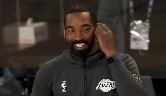 Los Angeles Lakers' JR Smith warms up prior to an NBA basketball game against the Los Angeles Clippers in Lake Buena Vista, Fla., in this Thursday, July 30, 2020, file photo. The 16-year NBA veteran who won two world championships is now a freshman walk-on for the North Carolina A&T men's golf team. He has college eligibility after going straight from high school to the NBA in 2004 instead of playing college basketball at North Carolina. (Mike Ehrmann/Pool Photo via AP, File) **FILE**