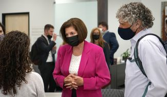 Sen. Catherine Cortez Masto, D-Nev., center, meets with people after speaking about the infrastructure bill at the Reno-Sparks Chamber of Commerce in Reno, Nev., Monday Aug. 23, 2021. Cortez Masto said infrastructure investments, tax credits for renewable energy projects and incentives to site solar and wind projects on former mines, would create jobs and protect the environment for future generations.  (AP Photo/Samuel Metz) **FILE**