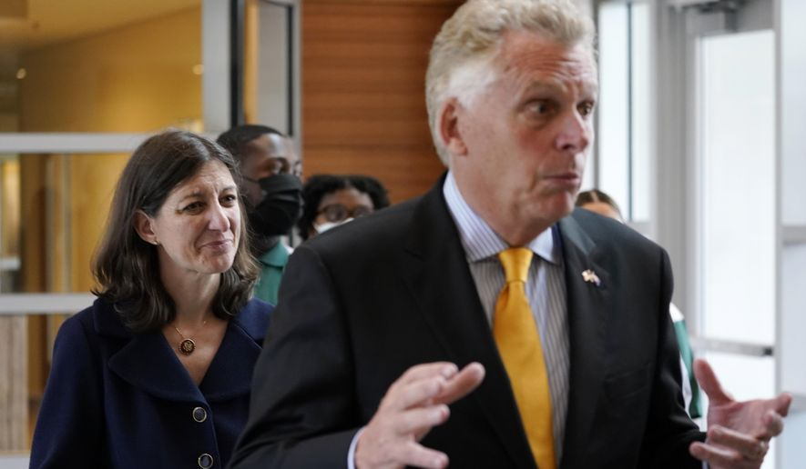 This July 15, 2021, file photo shows Democratic gubernatorial candidate former Gov. Terry McAuliffe, right, and U.S. Rep. Elaine Luria, D-Va., during a tour of Norfolk State University Thursday, July 15, 2021, in Norfolk, Va.  (AP Photo/Steve Helber) ** FILE **