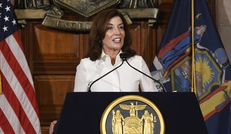 New York Gov. Kathy Hochul speaks to reporters after a ceremonial swearing-in ceremony at the state Capitol, Tuesday, Aug. 24, 2021, in Albany, N.Y. (AP Photo/Hans Pennink)