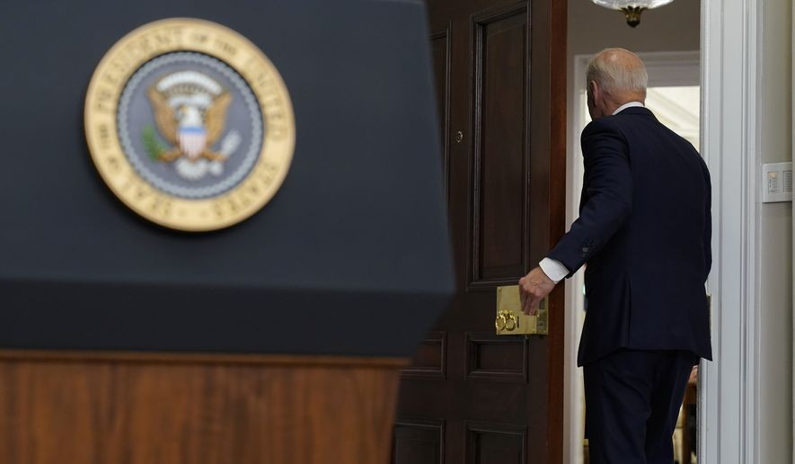President Joe Biden walks out of the room after speaking about the situation in Afghanistan from the Roosevelt Room of the White House in Washington, Tuesday, Aug. 24, 2021. (AP Photo/Susan Walsh)