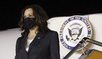 U.S. Vice President Kamala Harris arrives at the airport in Hanoi, Vietnam, Tuesday, Aug. 24, 2021. Harris is on a weeklong trip through Southeast Asia. (Evelyn Hockstein/Pool Photo via AP)