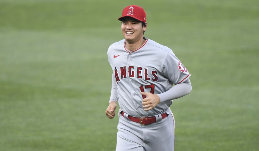 Los Angeles Angels' Shohei Ohtani (17) jogs on the field before a baseball game against the Baltimore Orioles, Tuesday, Aug. 24, 2021, in Baltimore. (AP Photo/Terrance Williams)