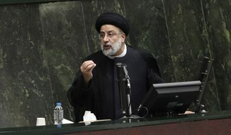 In this file photo, President Ebrahim Raisi defends his proposed ministers in a session of parliament, in Tehran, Iran, Wednesday, Aug. 25, 2021. Iran's hard-liner dominated parliament Wednesday voted to approve most of the proposed ministers of the newly elected president. (AP Photo/Vahid Salemi)  **FILE**