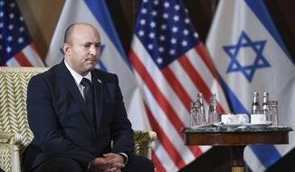 Israeli Prime Minister Naftali Bennett meets with Secretary of State Antony Blinken at the Willard Hotel in Washington, Wednesday, Aug. 25, 2021. (Olivier Douliery/Pool via AP) **FILE**