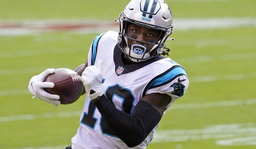 FILE - In this Nov. 8, 2020, file photo, Carolina Panthers wide receiver Curtis Samuel (10) runs to the end zone against the Kansas City Chiefs during the first half of an NFL football game in Kansas City, Mo. Washington has been practicing without receiver Curtis Samuel for the balance of training camp and without cornerback William Jackson for the past week. Samuel and Jackson were the team's highest-priced free agent additions.(AP Photo/Orlin Wagner, File)
