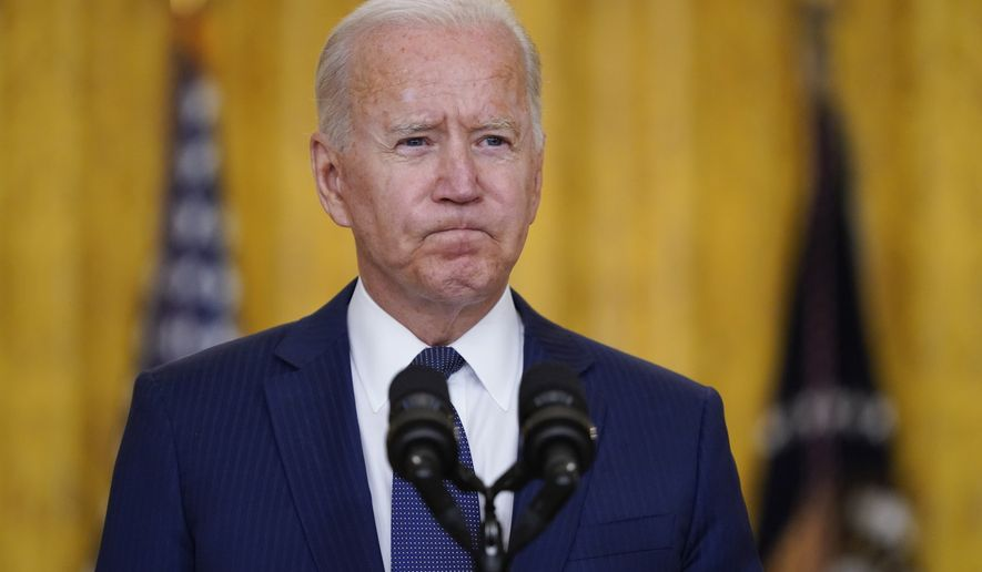 President Joe Biden pauses as he speaks about the bombings at the Kabul airport that killed at least 12 U.S. service members, from the East Room of the White House, Thursday, Aug. 26, 2021, in Washington. (AP Photo/Evan Vucci)
