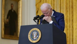 President Joe Biden pauses as he listens to a question about the bombings at the Kabul airport that killed at least 12 U.S. service members, from the East Room of the White House, Thursday, Aug. 26, 2021, in Washington. (AP Photo/Evan Vucci)
