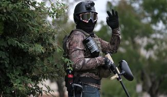 A member of the far-right group Proud Boys flashes an OK sign with their hand as they rally in an abandoned parking lot on the outskirts of town on Sunday, Aug. 22, 2021, in Portland, Ore. (AP Photo/Alex Milan Tracy)