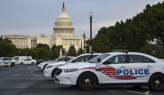Washington Metropolitan Police vehicles hold on the perimeter of the Capitol in Washington, Thursday evening, Aug. 26, 2021.  (AP Photo/J. Scott Applewhite)