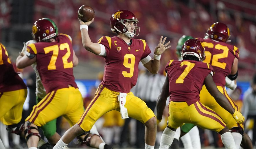 In this Dec 18, 2020, file photo, Southern California quarterback Kedon Slovis (9) throws a pass during the second quarter of an NCAA college football Pac-12 Conference championship game in Los Angeles. About 16 starters return from last season's Pac-12 South champions, led by third-year starting quarterback Kedon Slovis with USC's usual wealth of skill-position talent around him. (AP Photo/Ashley Landis, File) **FILE**