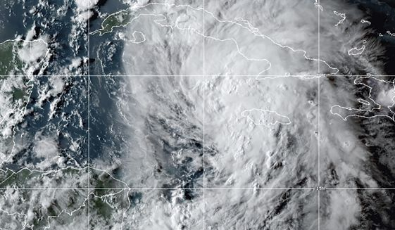 This OES-16 East GeoColor satellite image taken Thursday, Aug. 26, 2021, at 10:20 p.m. EDT, and provided by NOAA, shows Tropical Storm Ida in the Caribbean Sea. Tropical Storm Ida formed in the Caribbean on Thursday and forecasters said its track was aimed at the U.S. Gulf Coast, prompting Louisiana's governor to declare a state of emergency and forecasters to announce a hurricane watch for New Orleans. (NOAA via AP)