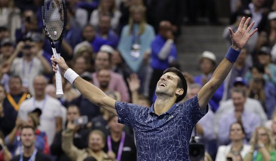 Novak Djokovic, of Serbia, celebrates after defeating Juan Martin del Potro, of Argentina, in the men's final of the U.S. Open tennis tournament in New York, in this Sunday, Sept. 9, 2018, file photo. Djokovic's pursuit of tennis history -- the first calendar-year Grand Slam by a man in more than a half-century and a men's-record 21st major title -- means all eyes will be on him when he is on the court at the U.S. Open. (AP Photo/Julio Cortez, File) **FILE**