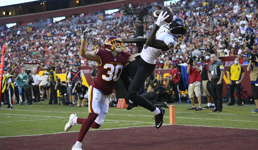 Baltimore Ravens wide receiver Ben Victor (81) makes a touchdown catch against Washington Football Team defensive back Troy Apke (30) during the first half of a preseason NFL football game, Saturday, Aug. 28, 2021, in Landover, Md. (AP Photo/Nick Wass)