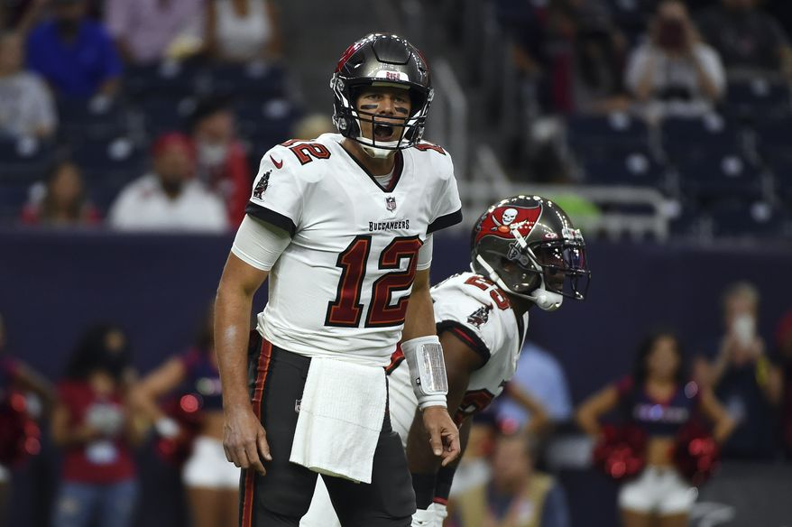 Tampa Bay Buccaneers quarterback Tom Brady (12) calls a play against the Houston Texans during the first half of an NFL preseason football game Saturday, Aug. 28, 2021, in Houston. (AP Photo/Eric Christian Smith)