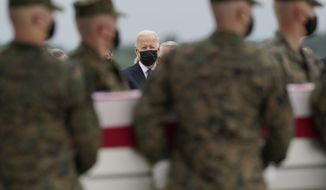 President Joe Biden watches as a carry team moves a transfer case containing the remains of Marine Corps Cpl. Humberto A. Sanchez, 22, of Logansport, Ind., during a casualty return Sunday, Aug. 29, 2021, at Dover Air Force Base, Del. According to the Department of Defense, Sanchez died in an attack at Afghanistan's Kabul airport, along with 12 other U.S. service members. (AP Photo/Carolyn Kaster)