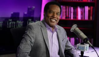 In this July 12, 2021 file photo, radio talk show host Larry Elder and Republican candidate  for California governor, poses for a photo in his studio in Burbank, Calif. (AP Photo/Marcio Jose Sanchez, File)