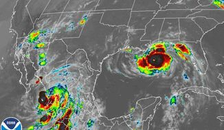 This image provided by the National Oceanic and Atmospheric Administration (NOAA) shows severe weather systems, Hurricane Nora, lower left, and Hurricane Ida, right, over the North American continent on Sunday, Aug. 29, 2021. Hurricane Nora is churning northward up Mexico's Pacific Coast toward the narrow Gulf of California, after making a sweep past the Puerto Vallarta area. (NOAA via AP)