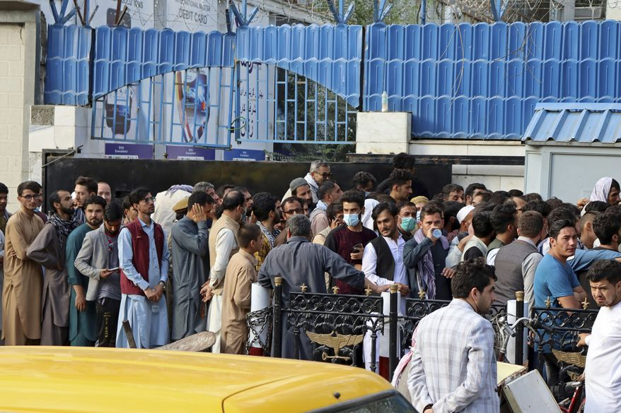 Afghans wait in long lines for hours to try to withdraw money, in front of a Bank in Kabul, Afghanistan, Monday, Aug. 30, 2021. Many Afghans are anxious about the Taliban rule and are figuring out ways to get out of Afghanistan. But it's the financial desperation that seems to hang heavy over the city. (AP Photo/Khwaja Tawfiq Sediqi)