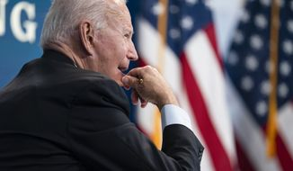 President Joe Biden listens during a virtual meeting with FEMA Administrator Deanne Criswell and governors and mayors of areas impacted by Hurricane Ida, in the South Court Auditorium on the White House campus, Monday, Aug. 30, 2021, in Washington. (AP Photo/Evan Vucci)g