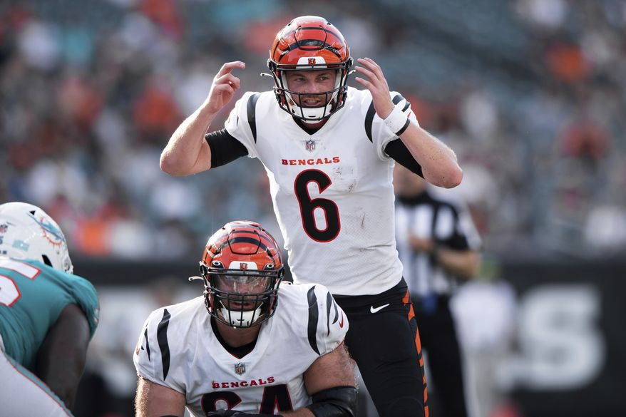 Cincinnati Bengals quarterback Kyle Shurmur (6) signals the offensive line during an NFL football game against the Miami Dolphins, Sunday, Aug. 29, 2021, in Cincinnati. (AP Photo/Zach Bolinger)