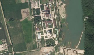 In this satellite photo released by Planet Labs Inc., North Korea's main nuclear complex is seen in Yongbyon, North Korea, just north of the capital, Pyongyang, July 27, 2021. North Korea appears to have restarted the operation of its main nuclear reactor used to produce weapons fuels, the U.N. atomic agency said, as the North openly threatens to enlarge its nuclear arsenal amid long-dormant nuclear diplomacy with the United States. In the image, North Korea's 5-megawatt nuclear reactor is seen to the building to the north, while the experimental light water reactor is the building with the circular feature atop it to the south. (Planet Labs Inc. via AP) ** FILE **