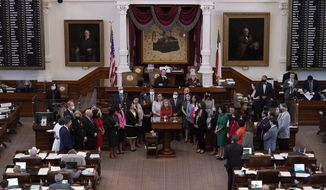 In this May 5, 2021, photo, Texas state Rep. Donna Howard, D-Austin, center at lectern, stands with fellow lawmakers in the House Chamber in Austin, Texas, as she opposes a bill introduced that would ban abortions as early as six weeks and allow private citizens to enforce it through civil lawsuits, under a measure given preliminary approval by the Republican-dominated House. Abortion providers in Texas are asking the Supreme Court to prevent enforcement of a state law that would allow private citizens to sue anyone for helping a woman get an abortion after about six weeks of pregnancy. (AP Photo/Eric Gay) **FILE**