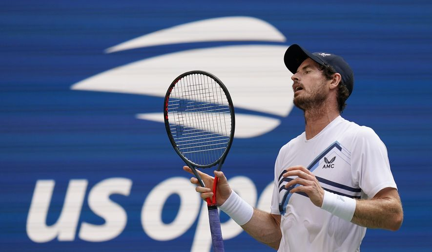 Andy Murray, of Great Britain, reacts after losing a point to Stefanos Tsitsipas, of Greece, during the first round of the US Open tennis championships, Monday, Aug. 30, 2021, in New York. (AP Photo/Seth Wenig)