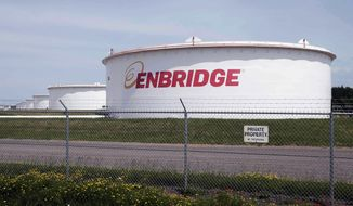 """This June 29, 2018 file photo shows tanks at the Enbridge Energy terminal in Superior, Wis. The state of Minnesota has gone to federal court to block a lawsuit over Enbridge Energy's Line 3 oil pipeline project from proceeding in tribal court. The novel case names Manoomin — the Ojibwe word for wild rice — as the lead plaintiff. Wild rice is sacred in Ojibwe culture and a traditional source of food. The lawsuit, which was filed two weeks ago in the White Earth Band's tribal court, isthe first """"rights of nature"""" enforcement case brought in a U.S. tribal courtand the second such case to be filed in any U.S. court. (AP Photo/Jim Mone, File)  **FILE**"""